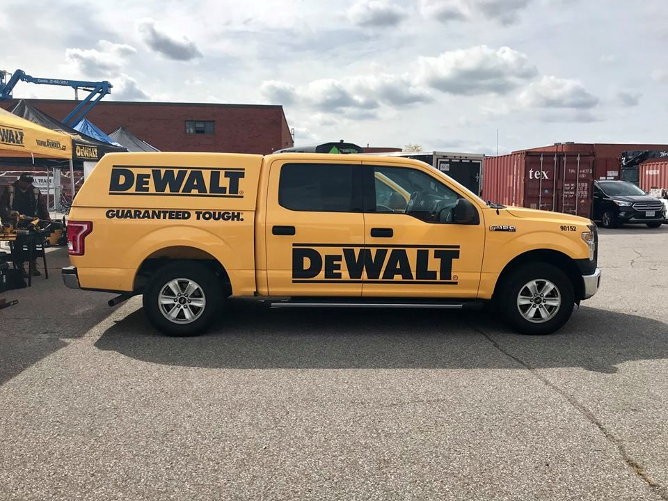 Yellow DeWalt truck on road